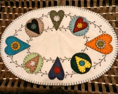 Multicolored Heart and Pip Vine Primitive Penny Rug