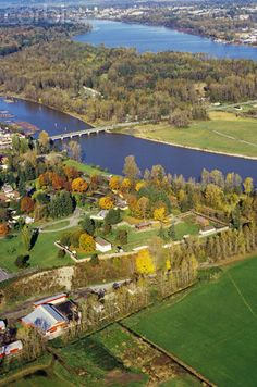 Fort Langley  on the south side of Fraser river. Large white building is main building in the fort.