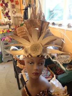 One of my favorites... a one of a kind tapa, lauhala, coconut fiber headpiece for Tahitian Dancing. hulamelani.etsy.com