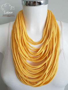 Handmade multi strand necklace. Made of mustard yellow t-shirt yarn (cotton fabric) That is very light and soft.  This beautiful necklace will jazz up any plane outfit. For cleaning, wash by hand and dry naturally.  I can make this necklace in different colors and sizes for you, so please feel free to contact me.  Please visit me on facebook: https://www.facebook.com/lulaor  And Instagram: www.instagram.com/lulaorcrochet