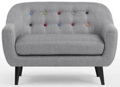 Die Knöpfe in intensiven Regenbogenfarben machen den Sessel zum Highlight im Kinderzimmer.