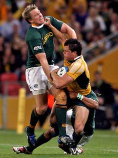 Australia's Adam Ashley-Cooper is tackled by South Africa's Jean de Villiers