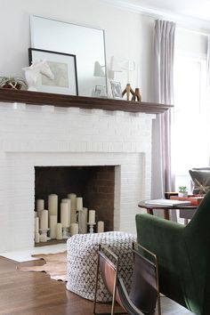 Home With Sarah Gibson in Dayton, Ohio Fill an unusable fireplace with different sized candles and holders in the same color.Fill an unusable fireplace with different sized candles and holders in the same color. Empty Fireplace Ideas, Unused Fireplace, Fireplace Pictures, Candles In Fireplace, Fake Fireplace, White Fireplace, Living Room With Fireplace, Fireplace Design, My Living Room