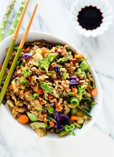 Learn how to make vegetable fried rice—it's a simple and satisfying dinner! This recipe features extra vegetables and brown rice. Vegetarian/gluten free.