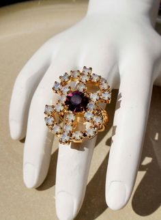 Vintage Sarah Coventry Gold ring with purple and white stones. $21.99, via Etsy.