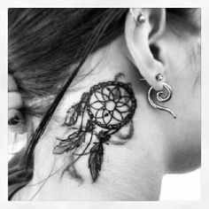 Dreamcatcher tattoo behind ear I think I'd like this better on my forearm. But if placed here, then smaller.