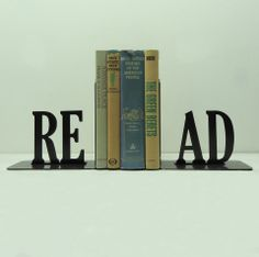 I have these metal art bookends from Etsy. They look so cool:)