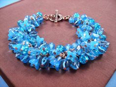 Flower Charm Bracelet Aqua Blue Bouquet Rose Gold by justCHARMING, $30.00  https://www.etsy.com/listing/45497958/flower-charm-bracelet-aqua-blue-bouquet