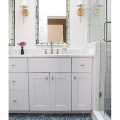 Pattern play! Shannon Eddings Interiors did a great job of echoing the floor tile design in the chevron mirrors by @westelm  Tiles: Cement Tile Shop, Tess I • • • #interior #interiors #bathroom #decor #style #interiordesign #interiordesigner #homedecor #vanity #chevron #luxury #homedesign #design #instadecor #decor #interiorinspiration #designinspiration