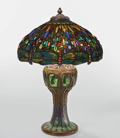 """Tiffany Studios """"DRAGONFLY"""" TABLE LAMP - Shade impressed TIFFANY STUDIOS NEW YORK,  base impressed TIFFANY STUDIOS/NEW YORK/355, leaded glass, favrile mosaic glass and patinated bronze, 32 5/8  in. (82.9 cm) high 22 5/8  in. (57.5 cm) diameter of shade, circa 1910, with a rare """"Mosaic and Turtle-Back"""" base. Auction Estimate  $600,000 — $900,000 USD"""