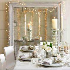 Christmas decoration ideas. I like the lights framing through mirror.