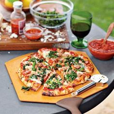 Outdoor Pizza & Wine Party    Pizza takes on an entirely new character when cooked on the grill or in a pizza oven outdoors, with a slightly smoky flavor and crisp, blistered crust. Paired with robust wines on a warm evening, this party menu is satisfying and simple to pull off -- especially if you prep pizza dough and toppings the night before.   Click on photo for menu and recipes.
