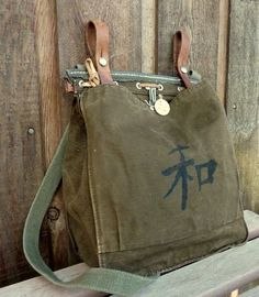 Hey, I found this really awesome Etsy listing at http://www.etsy.com/listing/73145408/vintage-military-satchel-hand-painted