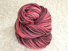 Goth Pink-- Hand dyed yarn Fingering weight Superwash by mustardseedyarnlab, $17.00