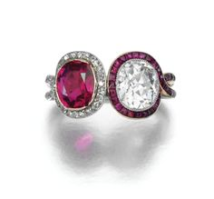 RUBY AND DIAMOND RING,  CIRCA 1910. Set with a cushion-shaped ruby within a border of single-cut diamonds and a cushion-shaped diamond within a border of calibré-cut rubies