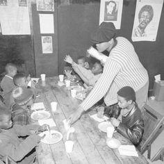 Brad Jones, wearing cap, member of the Philadelphia Black Panthers Organization, helps serve breakfast to youngsters, March 19, 1970   Source; AP / Bill Ingraham — at Philadelphia, Pennsylvania.