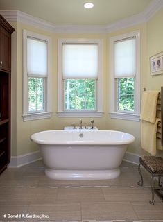 This gorgeous free-standing bathtub is perfect for relaxation. The Kenningstone #1166. http://www.dongardner.com/house-plan/1166/the-kenningstone. #MasterBathroom #HomeDesign #HomePlan