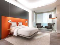 Modern Bedroom Design with Grey and Orange Color Scheme