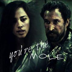 "Seychelle Gabriel as Lourdes and Noah Wyle as Tom Mason from the TV Show ""Falling Skies"". Still in shock the mole is Lourdes."