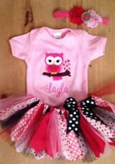 A scrap fabric and tulle tutu outfit in a Valentines Day owl theme. The outfit includes the tutu, shirt or baby bodysuit with owl applique and
