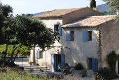 This house is located in Luberon, France. The owners, passionately interested in architecture and the art of living, have restored this old house in a spirit French Farmhouse, Country Farmhouse, French Country, Blue Shutters, Provence France, Tuscan Style, Stone Houses, South Of France, Cottage Homes