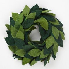Inviting Christmas wreath creates a warm holiday welcome for friends and family. Forever-fresh wool felt wreath spreads holiday cheer!