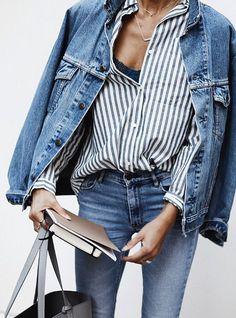 Layer up in double denim. Pair true blue denim with an oversized jean jacket, striped top and neutral leather tote bag for an easy everyday outfit.