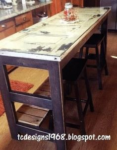 {DIY Kitchen Island} from {Old Door!}   probably too long for our kitchen but good idea