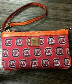 Rooney & Bourke South Carolina Wristlet - $88.00  Show your school spirit in style with our Collegiate Collection. Made of coated canvas and trimmed with bridle leather, this wristlet is small in size but big in style, with just enough room to carry your cards, cash and keys. Miss Cocky