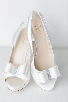 d026372b3331 Chic white Kate Spade wedding shoes  photo  Amalie Orrange Photography  Wedding Bows