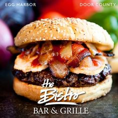 Bacon & Cheese Curd Burger // Our custom blend certified Angus beef patty topped with ale-braised caramelized onions, Door County Renards Cheese curds and smoky bacon. // Bistro at Liberty Square in Egg Harbor, WI, Door County