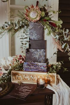 Rich Autumn Canterbury Wedding Inspiration black and purple luxe square wedding cake with a king protea and other greenery on top Square Wedding Cakes, Floral Wedding Cakes, Square Cakes, Wedding Flowers, Autumn Wedding, Summer Wedding, Paper Lace, Cake Table, King Protea