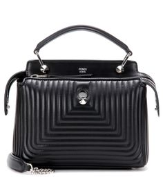 Fendi - Dotcom Click Small leather shoulder bag - Fendi's Dotcom Click Small shoulder bag is a compact version of the iconic Dotcom style. The quilted leather creates a textured geometric finish, while glossy silver-tone hardware elevates the piece to luxe-level status. This organisational accomplice comes with two zipped compartments and a detachable pouch which can double as a handy lunchtime clutch or wallet. seen @ www.mytheresa.com
