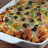 Tator Tot Taco Bake. Added homemade enchilada sauce instead of canned for no added sugar and more kick!