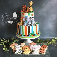 Jungle themed party cake with coordinating cookies. Cookies are painted on royal icing. All jungle animals are fondant Jungle Theme Parties, Party Themes, Fondant Figures, Jungle Animals, Little Man, Baby Shower Cakes, Party Cakes, Hand Painted, Cookies