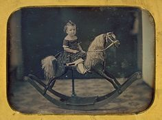 """daguerreotype of """"mirthless child on rocking horse"""""""
