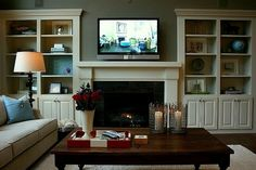 Built in shelves idea for family room. Favorite Paint Colors: family room/living room (Quiver Tan by Sherwin Williams). Also loving the built-ins. Bookshelves Around Fireplace, Bookshelves Built In, Built Ins, Bookcases, Book Shelves, Decorate Bookshelves, Fireplace Mantle, Fireplace Seating, Bookcase Wall