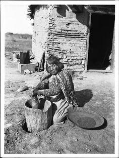 Mojave woman pounding Mesquite Beans - circa 1900