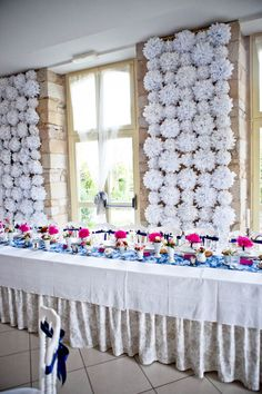 A wall of paper flowers