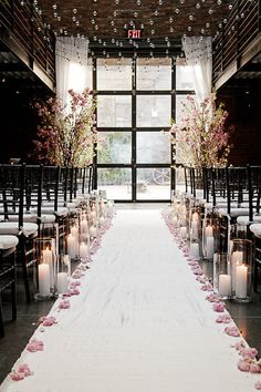 Ceremony.  Love the tall ceiling, as well as flowers and candles lining the walkway.  Creates an intimate setting for such a large room.  Would add more gold to bring it in line with my colors.