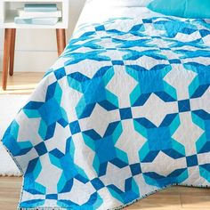 Use half-square triangles to make this easy quilt project. Download the pattern for the Wild Rose Quilt designed by Jenn Nevitt today >>