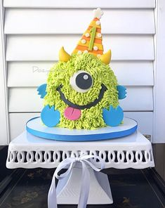 This design is a re-creation of monster smash cake. I added the party hat for some extra fun. The fur is easily created using a large grass tip. The details are fondant and gumpaste. Monster Smash Cakes, Monster Birthday Cakes, Little Monster Birthday, Monster 1st Birthdays, Monster Cupcakes, Monster Birthday Parties, Baby Birthday Cakes, 1st Boy Birthday, Cake Smash Cakes