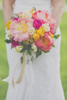 Bright pink and yellow bouquet filled with white blooms, ranunculus, craspedia and beautiful peonies   Photo: Blink of an Eye Photography   Bouquet: Floral V Designs