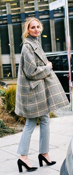 Vogue's Lauren Santo Domingo in a plaid coat and grey wool pants with black suede heels