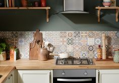 This Shaker kitchen has a simple white matt door, which has been paired with a wooden worktop to create a classic design. Mosaic tiles give a Mediterranean feel to your kitchen. This is the Allendale Antique White from Howdens.  Take look for more shaker style kitchen ideas and inspiration.
