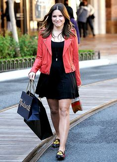 Sophia Bush pairs a red leather jacket over a black dress for a day of shopping