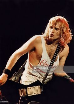 Phil Collen of Def Leppard performs on stage at Hammersmith Odeon on December 1983 in London England Def Leppard, Great Bands, Cool Bands, Freddie Mercury Tribute Concert, Vivian Campbell, Phil Collen, Rick Savage, Joe Elliott, Rock Of Ages