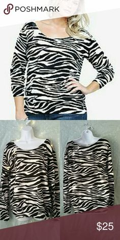 """Torrid Zebra print sweater ???????????? ??Fast Shipping ??Smoke Free Home  ?? Pet Friendly Home ? Always Clean & Packaged Well ?? Bundle to Save More ?? ?? I Consider All Reasonable Offers ??  Length of sweater laying flat is 27"""" Bust laying flat is 23.5"""" Length of sleeves laying flat is 26.5"""" torrid Sweaters Crew & Scoop Necks"""