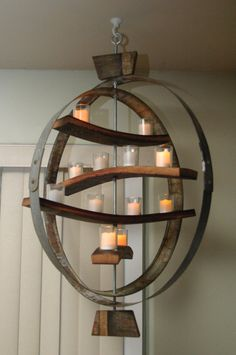 Unique candle holder using both the wooden staves and iron hoops from a wine barrel. With ceiling medallion in dining room?
