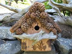 Wood bird house. {Unique pine cone roof line accents & bark/driftwood roof. Nice detailing using a woodburner tool (click pin to see more designs). Omit drift wood perch so no predator birds can access young in nest.}